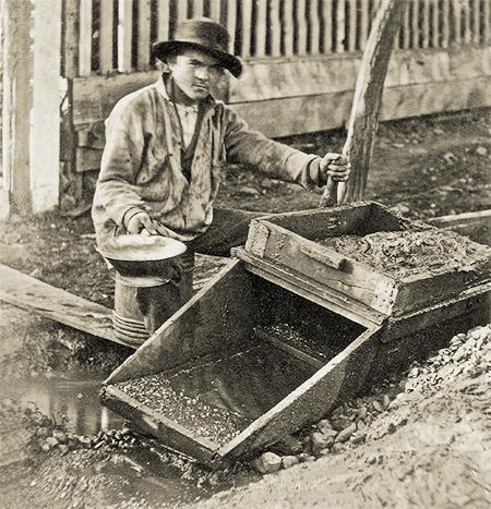 Goldrush Miner using rocker in Columbia California - Columbia State Historic Park